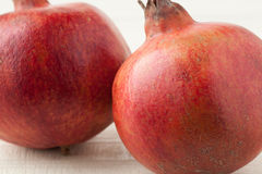 Two red pomegranates Stock Photography