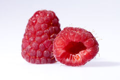 Two red raspberries isolated on white background Royalty Free Stock Images