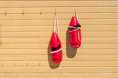 Two red rescue buoys Stock Photography