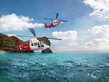 Two red rescue helicopter flying in blue sky Stock Photo