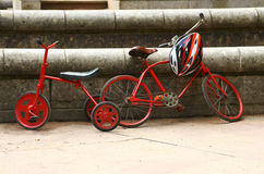 Two red retro bicycles Stock Photos