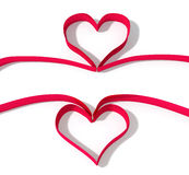 Two red ribbon as heart shape Stock Images