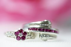 Two red round gemstone rings stacked beautifully in the background royalty free stock photo