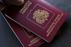 Two Red Russian passport to travel. Closeup. stock photo