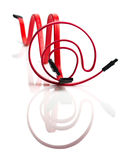 Two red SATA cables. SATA cables in the form of chart and at symbol Royalty Free Stock Photography