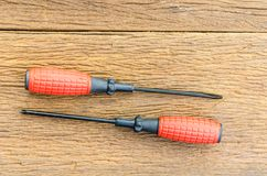 Two red screw driver Stock Photography