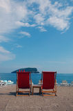 Two red seats at the bich. Beach with two red seats Royalty Free Stock Image