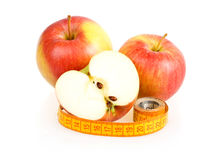 Two Red Sliced Apples and Measuring Tape Royalty Free Stock Photo