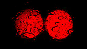 Two red spots texture over a wet reflection Royalty Free Stock Photos