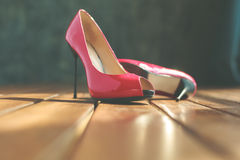 Two red stilettos Stock Images