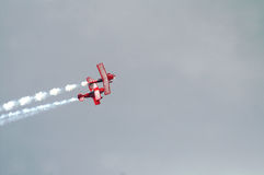 Two Red Stunt Planes. Leave White Smoke Trail Royalty Free Stock Photography
