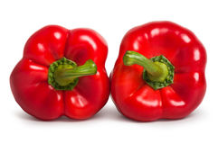 Two red sweet peppers lying next to each other. Two red sweet bulgarian peppers lying next to each other royalty free stock images