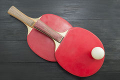 Two red table tennis rackets on dark background Stock Photo