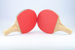 Two red table tennis rackets Stock Photography