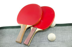 Two red table tennis rackets and a net isolated Stock Photography