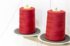 Two red thread coils. Threads for industrial sewing machines Stock Photography