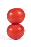 Two red tomatoes macro or close up on each other isolated Stock Images