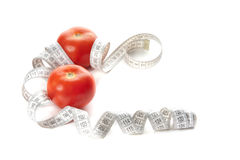 Two red tomatoes with tape measure Royalty Free Stock Photos