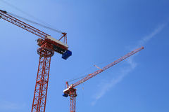 Two red tower cranes Stock Image