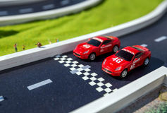 Two red toys racing cars Royalty Free Stock Photos