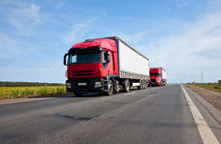 Two red trucks Royalty Free Stock Photo