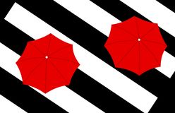 Two red umbrellas on stripes background Royalty Free Stock Photography