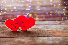 Two Red Valentine hearts smily and hug Stock Photography