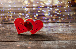 Two Red Valentine hearts smily and hug Royalty Free Stock Image