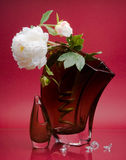 Two red vases with white flowers on pink Royalty Free Stock Photo