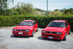 Two Red Vintage Lancia Delta Cars Stock Photography