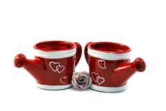 Two red watering cans Royalty Free Stock Photography