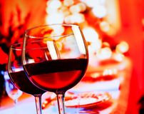 Two red wine glasses against restaurant table background Stock Photo