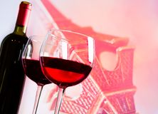 Two red wine glasses on blur tower Eiffel background. Festive and love concept Royalty Free Stock Images