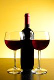 Two red wine glasses near bottle Stock Photo