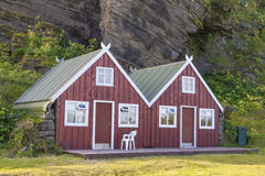 Two red wooden cottage - Vik, Iceland. Royalty Free Stock Photos