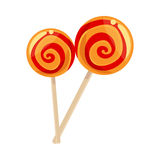 Two red and yellow striped lollypops Stock Photography