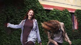 Two redheaded girlfriends goofing around and having fun. young girls with freckles. slow motion stock video