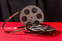 Two reel of film  on a red table. Reel of film  on a red table with black background Stock Images