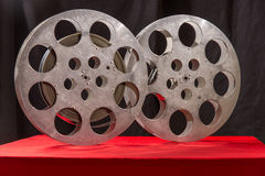 Two reel of film in retro. Movie reel on a red table fnd black background Royalty Free Stock Photography