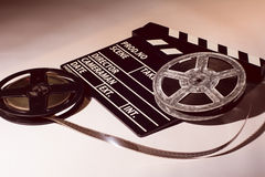 Two reels of film with a clap movie. Lying on a light table Stock Photography