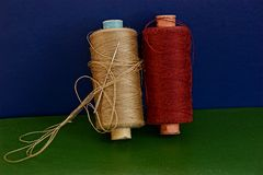 Two reels with threads on the table Stock Images
