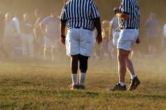 Two Referees. Referees on top of the action Royalty Free Stock Photography
