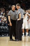 Two referees discuss a call during a game Stock Images