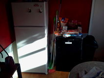 Two refrigerators in kitchen. Two fridges with food and kitchen stuff Stock Photos