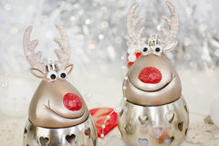 Two reindeer card design. Christmas table decoration with candle hearts  funny reindeer  bauble pearls moody decor vintage elegant Stock Images