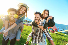 Two relaxed couples having fun stock photography