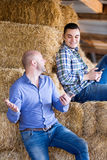 Two relaxed farm workers Stock Image