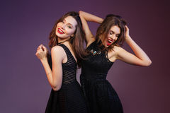 Two relaxed women i dancing and having fun royalty free stock image