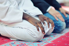 Two religious muslim man praying together inside the mosque Stock Photography
