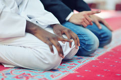 Two religious muslim man praying together inside the mosque Royalty Free Stock Photo